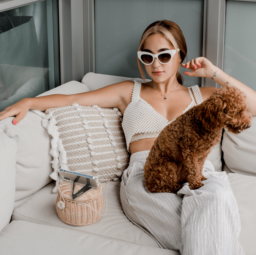 woman-in-sunglasse-sits-with-a-puppy